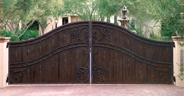wrought iron gate with corten
